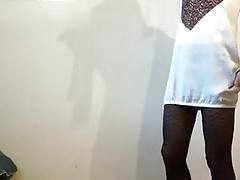 Crossdresser wearing dress and fishnet stockings