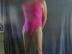 Sissy in a pink leotard shows his slut ass.