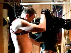 Rubber Slave in the Pillory